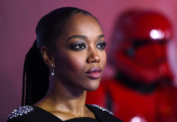 Naomi Ackie Long Braided Hairstyle [hair,face,lip,eyebrow,beauty,red,hairstyle,head,fashion,cheek,star wars: the rise of skywalker,european premiere of ``star wars: the rise of skywalker,european,england,london,cineworld leicester square,naomi ackie]