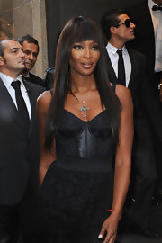 Naomi showcased her signature blunt cut bangs and long locks while hitting Milan Fashion Week.