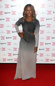 Alexandra Burke found way to elegantly show some skin in this serene gray ombre cutout gown.