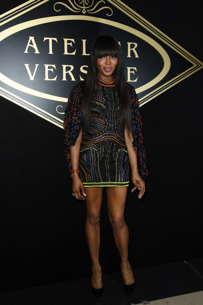 Naomi Campbell Bomber Jacket [haute couture fall,clothing,fashion,fashion show,runway,footwear,leg,fashion design,fashion model,model,dress,naomi campbell,atelier versace,front row,part,paris,france,atelier versace haute couture fall,paris fashion week,show]