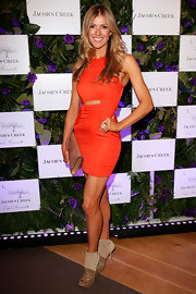 Laura Csortan topped off her orange mini dress with tan cutout platform booties.