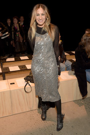 Sarah Jessica Parker shimmered at the Narciso Rodriguez fashion show in a metal ring-embellished midi dress from the label.