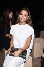 Jessica Alba paired a snakeskin clutch with a boxy white dress for the Narciso Rodriguez fashion show.