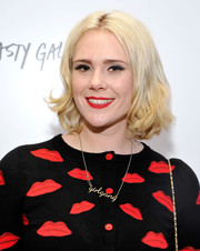 Kate Nash wore her hair short with a center part and curly ends during the Nasty Gal Melrose store launch.