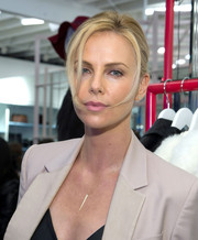 Charlize Theron pulled her hair back into a casual twisted bun for the Nasty Gal Melrose store launch.