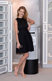 Natalia Vodianova chose a timeless little black dress with a full skirt for her appearance at the launch of Dior in Harrods in London.