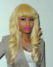 Nicki Minaj added a bright pop of color to her pink gloss by lining the lower lids of her eyes.