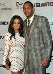 La La Anthony sported clashing prints with this leopard-print clutch and print dress combo at the NBPA All-Star Gala.