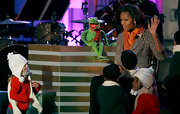 Michelle Obama looked adorable at the National Christmas Tree Lighting Ceremony in a color-specked tweed coat spruced up with a bright orange scarf.