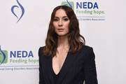 Troian Bellisario attended the National Eating Disorder Association benefit gala wearing her hair in shoulder-length, center-parted waves.
