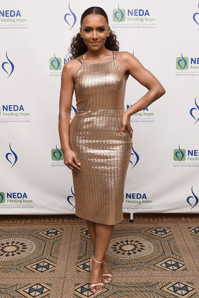 Janet Mock wowed in a sleeveless gold cocktail dress by Christian Siriano at the National Eating Disorder Association benefit gala.