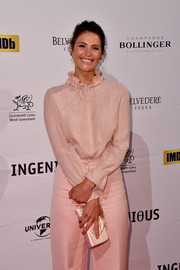 Gemma Arterton arrived for the National Film & Television School's gala carrying a lovely ivory satin clutch.