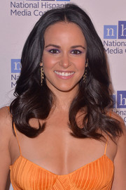 Melissa Fumero wore her hair down in bouncy curls at the Impact Awards.