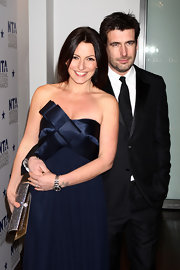 Davina McCall amped up the glam factor at the 2010 National Television Awards with a strapless gown teamed with a crystal-studded clutch.
