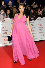 Teresa Palmer attended the 2019 National Television Awards wearing a Barbie-pink maternity halter gown by N°21.