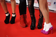 Worn with socks, Jade Thirlwall's glittery fuchsia platform pumps were reminiscent of Dorothy's ruby slippers.