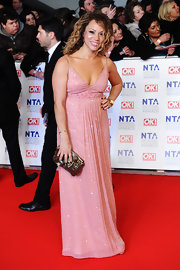 Angela Griffin accessorized her beaded pink gown with a metallic snakeskin clutch.