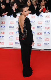 Georgia May Foote dazzled in a backless gown with gunmetal sequins for the National Television Awards.