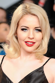 Lydia Bright added a jolt of color to her look with a glossy red lipstick at the National Television Awards.