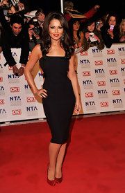 Cheryl is ultra sassy in a backless LBD with leather straps.