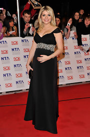 The mother-to-be is glowing in an off-the-shoulder black evening dress at the NTA Awards.