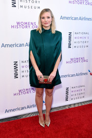 Kristen Bell channeled the '80s with this bold-shouldered emerald cape dress by August Getty Atelier at the Women Making History Awards.