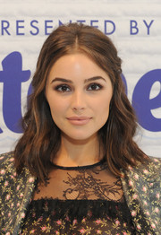Olivia Culpo looked sweet wearing this half-up wavy hairstyle while visiting the Nature's Bounty celebrity gift suite.