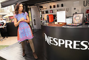 Padma Lakshmi contrasted her feminine frock with tough-looking ankle boots.