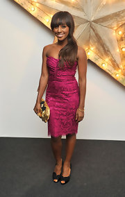 Alexandra Burke paired her hot pink bustier dress with black lace peep toe pumps by Dolce & Gabbana.