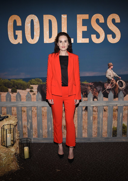 Michelle Dockery looked striking in a scarlet Cinq à Sept pantsuit teamed with a black shirt while celebrating 12 Emmy nominations for 'Godless.'