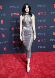 Krysten Ritter kept the shine going with a pair of silver pumps.