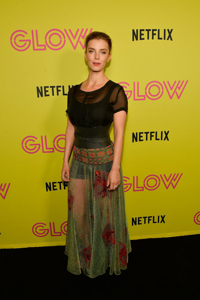 Betty Gilpin teamed her skirt with a sheer black top.