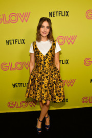 Alison Brie charmed in a floral jacquard dress by Isa Arfen at the 'Glow' roller-skating event.