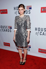 Kate Mara stepped out of her normal color scheme in this silver lace dress with clusters of beading.