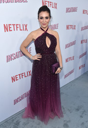 Alyssa Milano matched her dress with a satin envelope clutch by Tyler Ellis.