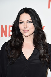 Laura Prepon styled her raven hair with a center part and gorgeous waves for the Netflix launch party in Paris.