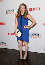 Natasha Lyonne put her figure on display in a tight blue zip-front mini during the 'Orange is the New Black' panel discussion.