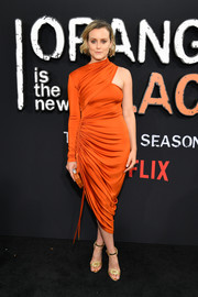 Taylor Schilling styled her frock with gold knot-detail sandals.