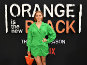 Madeline Brewer went for a bold color pairing with this red leather purse and green shirtdress combo at the premiere of 'Orange is the New Black' season 7.