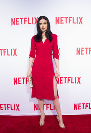 Krysten Ritter styled her dress with studded gold peep-toes by Jimmy Choo.