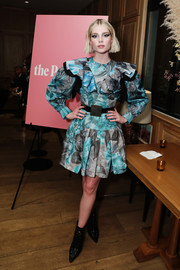 Lucy Boynton channeled the '80s in a printed mini dress with voluminous sleeves and a ruffled yoke at the LA Tastemaker event.