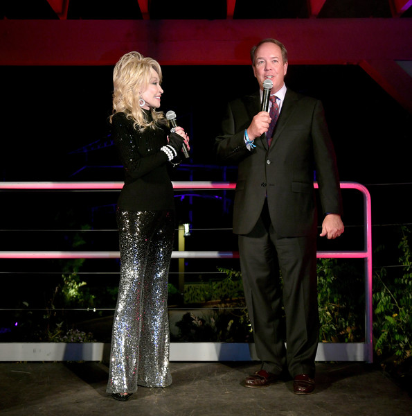 More Pics of Dolly Parton Turtleneck (4 of 28) - Dolly Parton Lookbook - StyleBistro [heartstrings,event,performance,fun,night,stage,formal wear,sport venue,dolly parton,craig ross,pigeon forge,tennessee,netflix,premiere]