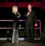 Dolly Parton spoke onstage at the premiere of 'Heartstrings' wearing a black turtleneck.