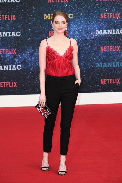 Emma Stone went for glamorous styling with a pair of bejeweled sandals by Louis Vuitton.