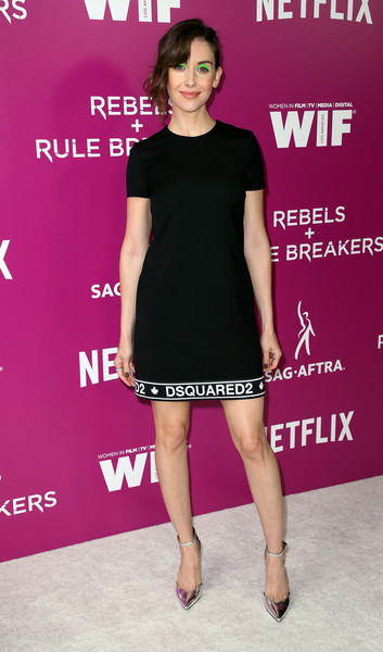 Alison Brie styled her LBD with silver ankle-strap pumps by Stella Luna.