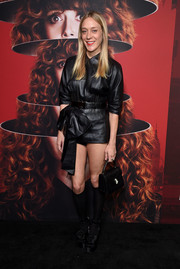 Chloe Sevigny completed her all-black ensemble with a Bulgari Serpenti purse.