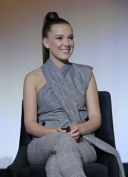 Millie Bobby Brown looked ultra modern in an asymmetrical glen plaid top and pants combo by Monse at the 'Stranger Things' Q&A and reception.