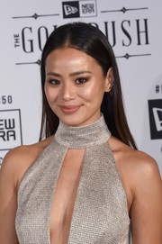 Jamie Chung wore her hair loose and straight with a center part during the New Era Style Lounge party.