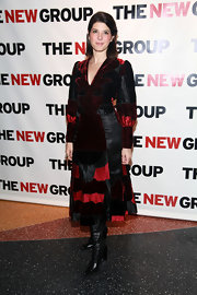 Marisa Tomei teamed her leather and velvet coat with black leather knee high boots.