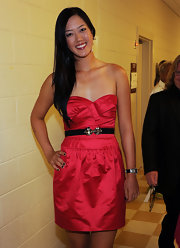 Michelle Wie looked super feminine in her strapless red mini dress at the World Leadership Awards.
